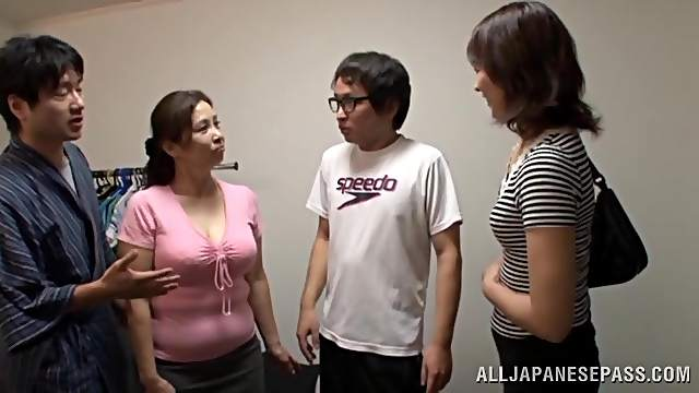 Two horny Japanese milfs share a weiner indoors in FFM sex clip