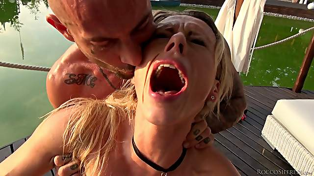 Muscular hung guys penetrating luscious babes by the water