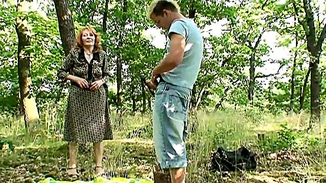 Lucky granny moans in pleasure while riding a cock in the forest
