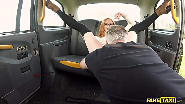Redhead chick Lenina Crowne with glasses fucked by the taxi driver