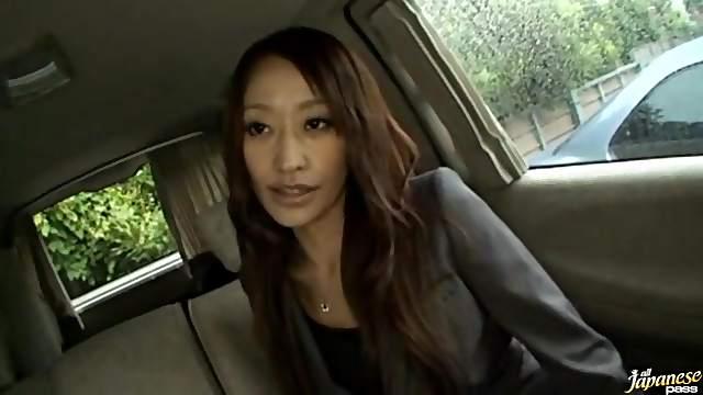 Gorgeous Japanese babe Yuu Kanda gives a blowjob in the van