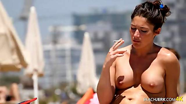 Drinking and smoking babe at the beach