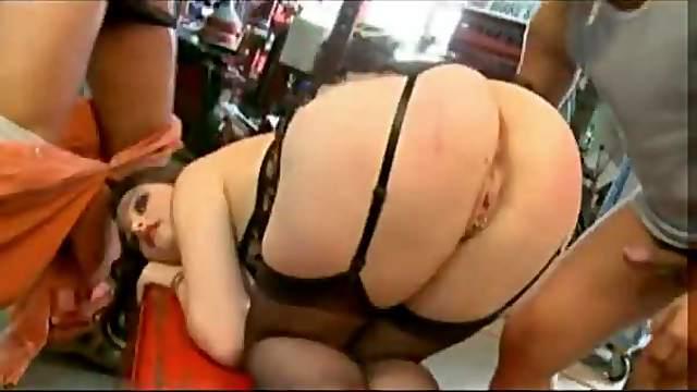 Girl in a sexy garter belt does a DP