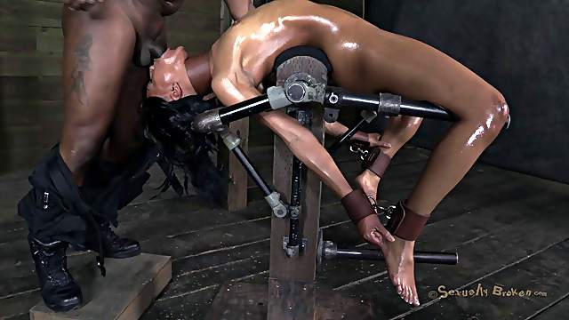 Ebony oiled and tied mercilessly in BDSM porn shoot