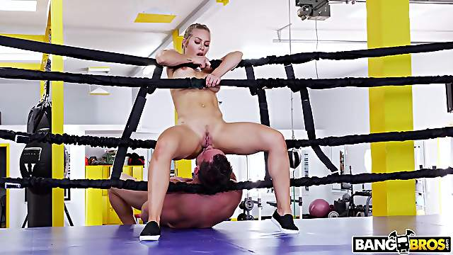 Fit fighter Nicole Aniston drops on her knees to suck his prick
