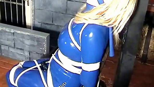 Bondage and latex fetish erotic clip with a hot blonde