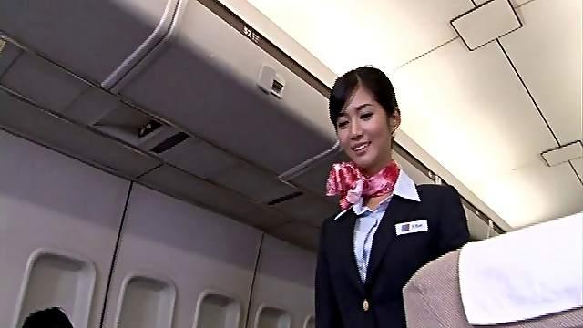 Japanese stewardess Nozomi Aso enjoys having sex with a pilot