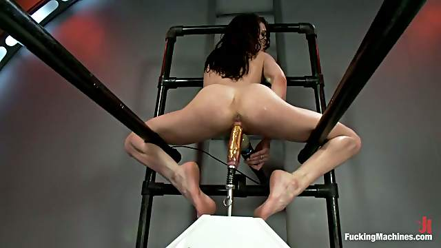 Aiden Ashley gets satisfied by a fucking machine in a basement