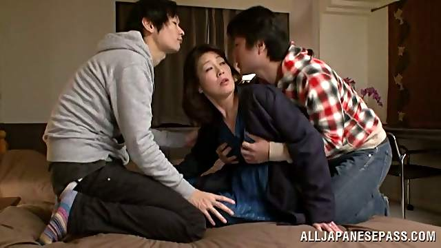 Japanese milf gets her hairy snatch fingered and fucked by two dudes