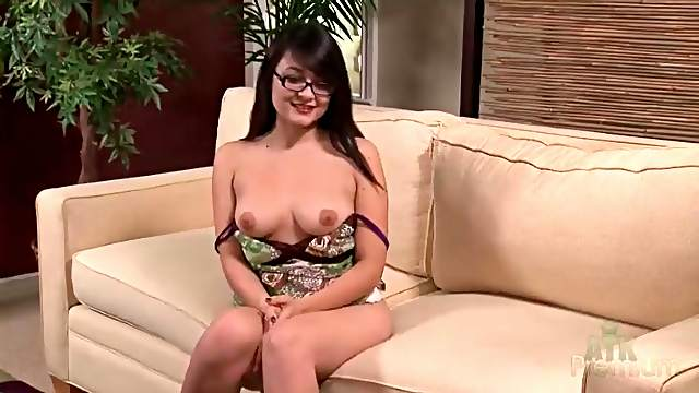 Glasses girl flashes her beautiful titties