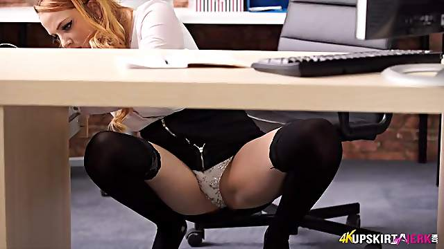 Redheaded secretary flashing her panties in the office