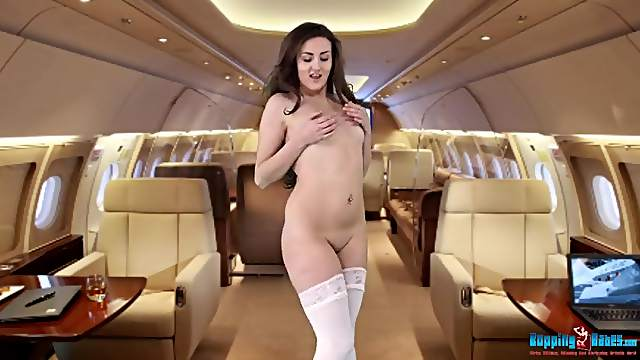 Stewardess on a private jet strips for you