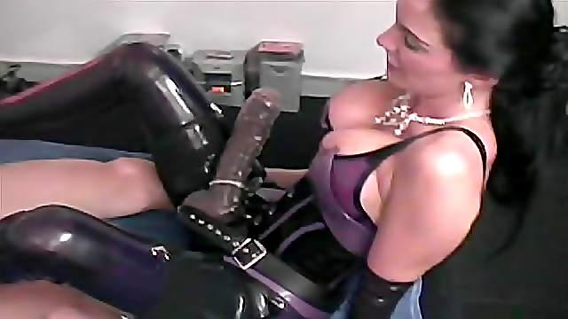 Latex mistress anally penetrates male slave