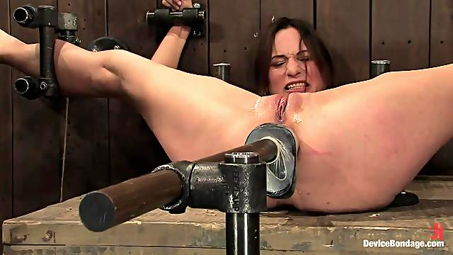 Kinky brunette's fucked up her ass by a machine while being tied up