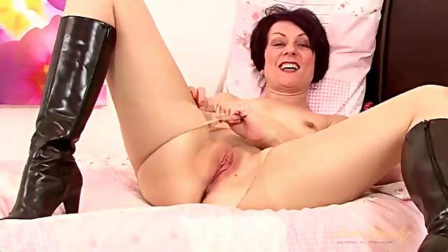 Sexy black leather boots on masturbating milf