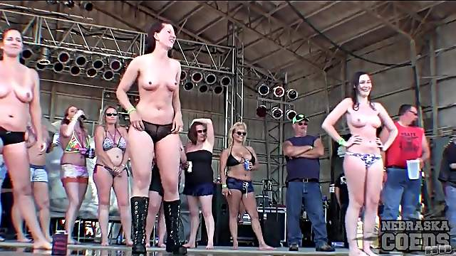Topless ladies dancing on rock stage