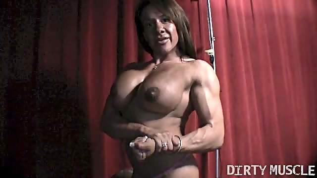 Female Bodybuilder Rubs Big Clit