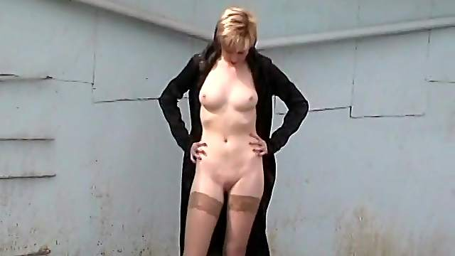 Young girl posing nude in public