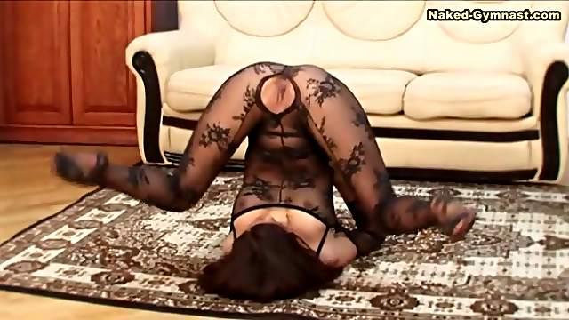 Flexible girl is sexy in black body stocking